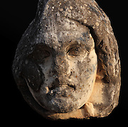 Giant sculpted head in the courtyard of Aphrodisias Museum, Aydin, Turkey. Aphrodisias was a small ancient Greek city in Caria near the modern-day town of Geyre. It was named after Aphrodite, the Greek goddess of love, who had here her unique cult image, the Aphrodite of Aphrodisias. The city suffered major earthquakes in the 4th and 7th centuries which destroyed most of the ancient structures. Picture by Manuel Cohen