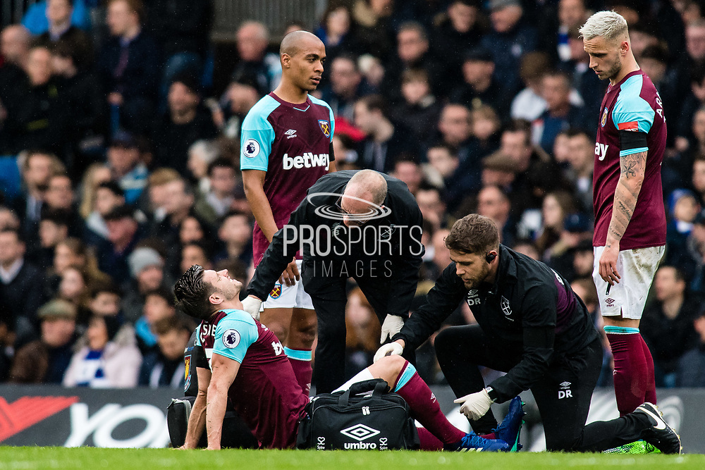injured West Ham  (3) Aaron Cresswell during the Premier League match between Chelsea and West Ham United at Stamford Bridge, London, England on 8 April 2018. Picture by Sebastian Frej.