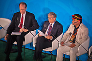 World Bank Group President David Malpass, left, with  Microsoft's Bill Gates middle, and right  and Indigenous Peoples Representative Tuntiak Katan, addresses the Climate Action Summit in the United Nations General Assembly, at U.N. headquarters on Monday, Sept. 23, 2019.