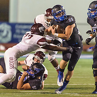 Friendswood #25 Sam Longbotham tries to break away from Clear Creek #32 Hisham Walker during the game at Winston Stadium in Friendswood 10/17/14