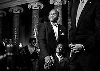 """WASHINGTON, DC - February 7: William """"Mo"""" Cowan was sworn in as the newest Senator from Massachusetts by Vice President Joe Biden, with his son, Grant, 4. Cowan will temporarily fill the seat opened by former Senator John Kerry's confirmation to Secretary of State, on Capitol Hill Thursday, February 7, 2013.  A special election will be held June 25 to permanently fill the seat.  (Photo by Melina Mara/The Washington Post)"""