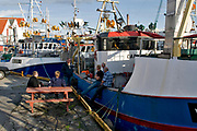 Fishermen in dock at Skudeneshavn, Karmöy, western Norway.