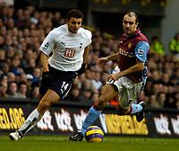 Photo: Ed Godden.<br /> Tottenham Hotspur v Aston Villa. The Barclays Premiership. 26/12/2006. Spurs' Hossam Ghaly (L), makes his way past Gavin McCann.