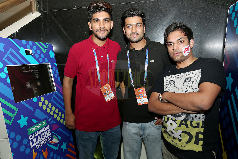 Staff at the spectator &quot;selfie-booth&quot; during match 2 of the Oppo Champions League Twenty20 between the Kings XI Punjab and the Hobart Hurricanes held at the Punjab Cricket Association Stadium, Mohali, India on the 18th September 2014. Photo by:  Jacques Rossouw / Sportzpics/ CLT20<br /> <br /> <br /> Image use is subject to the terms and conditions as laid out by the BCCI/ CLT20.  The terms and conditions can be downloaded here:<br /> <br /> http://sportzpics.photoshelter.com/gallery/CLT20-Image-Terms-and-Conditions-2014/G0000IfNJn535VPU/C0000QhhKadWcjYs