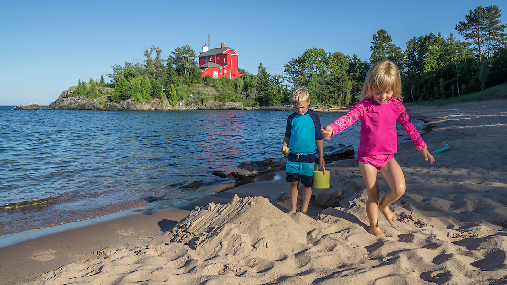 Family at McCarty Cove Beach on Lake Superior near the Marquette Lighthouse, Marquette, Michigan.