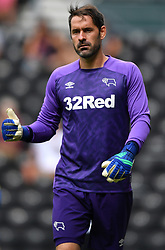 """Derby County goalkeeper Scott Carson during a pre season friendly match at Pride Park, Derby. PRESS ASSOCIATION Photo. Picture date: Saturday July 21, 2018. Photo credit should read: Anthony Devlin/PA Wire. EDITORIAL USE ONLY No use with unauthorised audio, video, data, fixture lists, club/league logos or """"live"""" services. Online in-match use limited to 75 images, no video emulation. No use in betting, games or single club/league/player publications."""