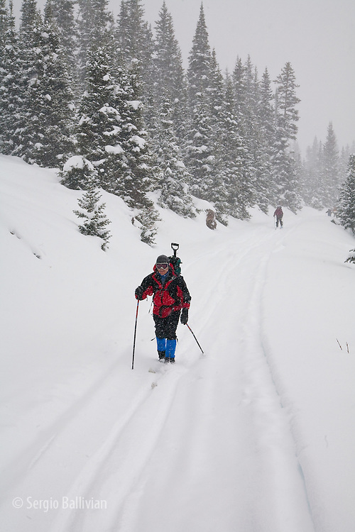 Backcountry skiers glide through fresh powder while touring to Peter Estin Hut in Colorado.  Being prepared for all weather and rapidly-changing conditions is essential to surviving  winter in Colorado.