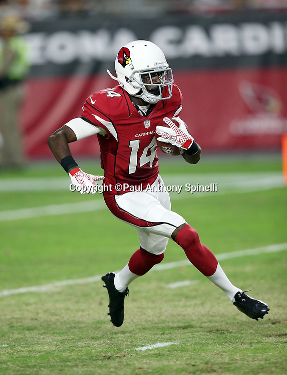 Arizona Cardinals punt returner J.J. Nelson (14) returns a punt during the 2015 NFL preseason football game against the Kansas City Chiefs on Saturday, Aug. 15, 2015 in Glendale, Ariz. The Chiefs won the game 34-19. (©Paul Anthony Spinelli)