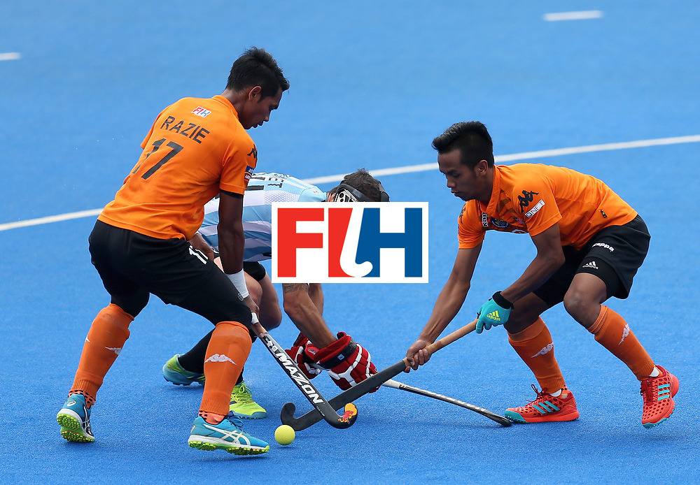 LONDON, ENGLAND - JUNE 24:  Razie Rahim of Malaysia and Faizal Saari of Malaysia battle for possession with Manuel Brunet of Argentina during the semi-final match between Argentina and Malaysia on day eight of the Hero Hockey World League Semi-Final at Lee Valley Hockey and Tennis Centre on June 24, 2017 in London, England.  (Photo by Steve Bardens/Getty Images)