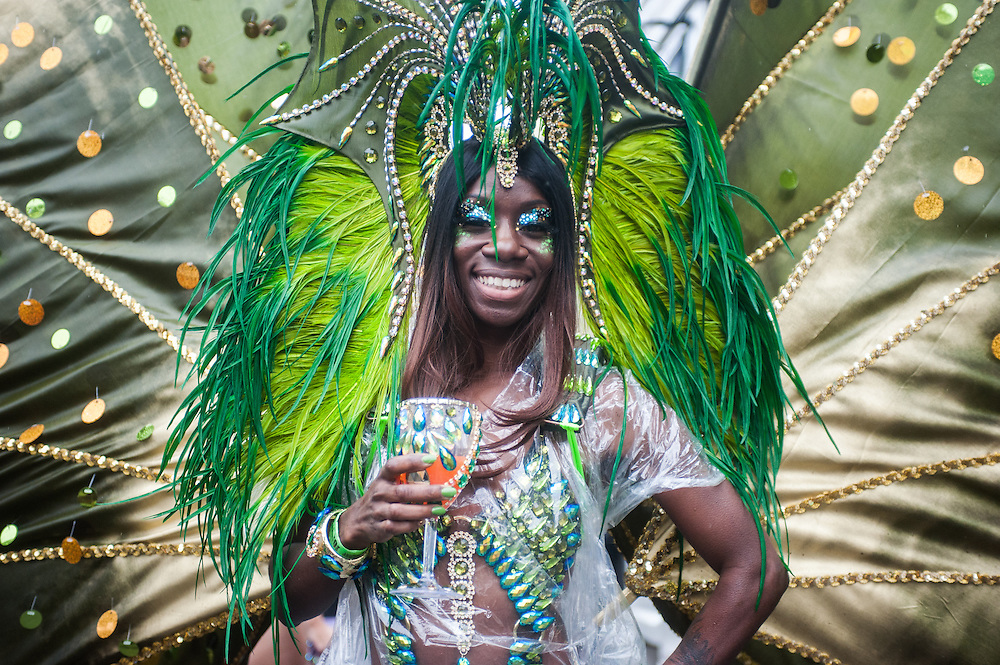 London, UK - 25 August 2014: a reveller takes part at the parade during the Notting Hill Carnival in London.