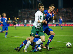 OSIJEK, CROATIA - Tuesday, October 16, 2012: Wales' Gareth Bale is hacked down by Croatia's Josip Simunic and Dejan Lovren during the Brazil 2014 FIFA World Cup Qualifying Group A match at the Stadion Gradski Vrt. (Pic by David Rawcliffe/Propaganda)