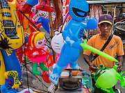 25 FEBRUARY 2015 - PHNOM PENH, CAMBODIA: An inflatable toy vendor near the Royal Palace in Phnom Penh.   PHOTO BY JACK KURTZ
