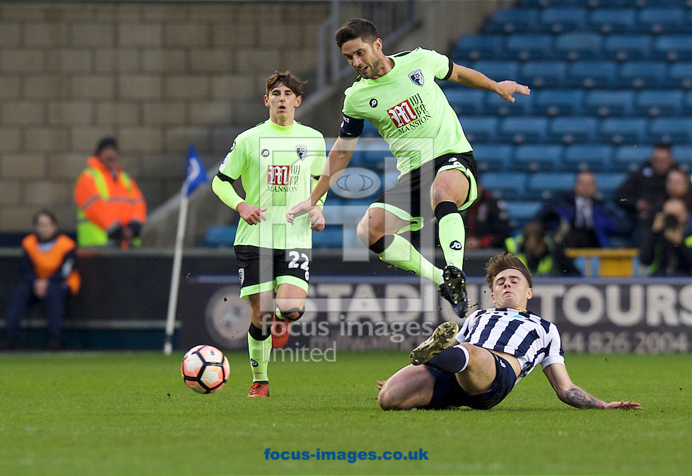 Ben Thompson of Millwall goes in with a sliding tackle on Andrew Surman of Bournemouth during the third round of the FA Cup at The Den, London<br /> Picture by Alan Stanford/Focus Images Ltd +44 7915 056117<br /> 07/01/2017