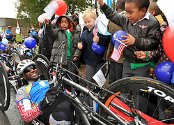 © Licensed to London News Pictures. 11/10/2012. Alfredo Delos Santos 42 from New York.  30 British and American wounded soldiers and veterans are welcomed by school children from St Alfege with St Peters School Greenwich. after riding into London, today 11 October 2012, after completing 'Soldier Ride'  The 30 serving and formers soldiers, all with life-changing injuries sustained in the line of duty, departed from Sandringham Estate, waved off by His Royal Highness the Duke of Edinburgh last Saturday. They travelled the Norfolk, Suffolk and Essex coast calling at Cromer, Great Yarmouth, Ipswich, Colchester, Southend-on-Sea, Rainham all the way to the finish line in Greenwich, London.  Riders used modified bikes, hand cycles and standard road bikes, depending on their needs. Photo credit : Rob Leyland/LNP