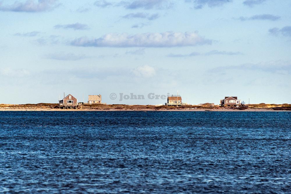 Remote beach cottages, Chatham, Cape Cod, Massachusetts, USA.
