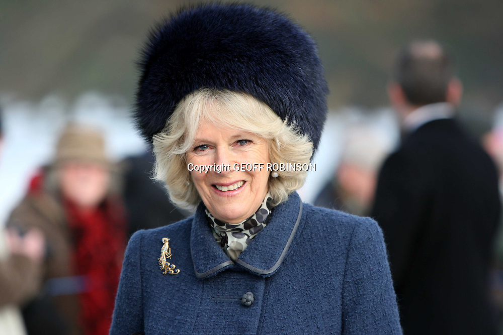 CAMILLA THE DUCHESS OF CORNWALL AT THE CHRISTMAS SERVICE AT SANDRINGHAM TODAY..Around 500 onlookers watched members of the Royal Family attend a Christmas Day church service on one of the Queen's estates...Security was tight as the Queen and Duke of Edinburgh arrived for the service at St Mary Magdalene church on the Sandringham Estate near King's Lynn, Norfolk...The royals gathered earlier this week to spend Christmas at Sandringham...The Prince of Wales and the Duchess of Cornwall; Princes William and Harry; the Princess Royal and her husband, Vice Admiral Timothy Laurence; the Duke of York and his daughters Princesses Beatrice and Eugenie; the Earl and Countess of Wessex; Peter Phillips, and his wife Autumn; and Zara Phillips were among family members who joined the Queen at the service, led by Sandringham rector Jonathan Riviere...Most of the party - including the Duke of Edinburgh - walked the quarter mile from Sandringham House to the church along an icy path...Police searched visitors as they arrived and more than a dozen officers also kept a close eye on crowds lining the path along which the royals walked...