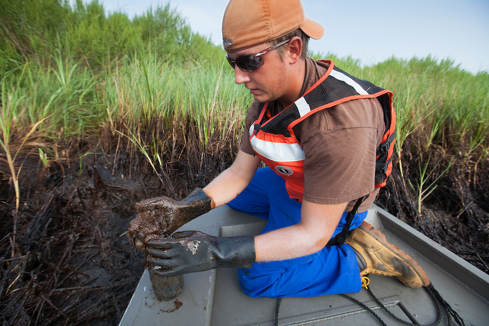 August, 8, 2010,  Jesse Shaffer the 4th, collects samples of soil in  Bay Jimmy where BP oil spill had the greatest impact.