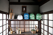 at a tourist destination safety helmets are stored in case of an earthquake Tokyo Japan