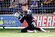 AFC Wimbledon goalkeeper Joe McDonnell (24) stopping a shot whilst warming up during the EFL Sky Bet League 1 match between AFC Wimbledon and Doncaster Rovers at the Cherry Red Records Stadium, Kingston, England on 26 August 2017. Photo by Matthew Redman.