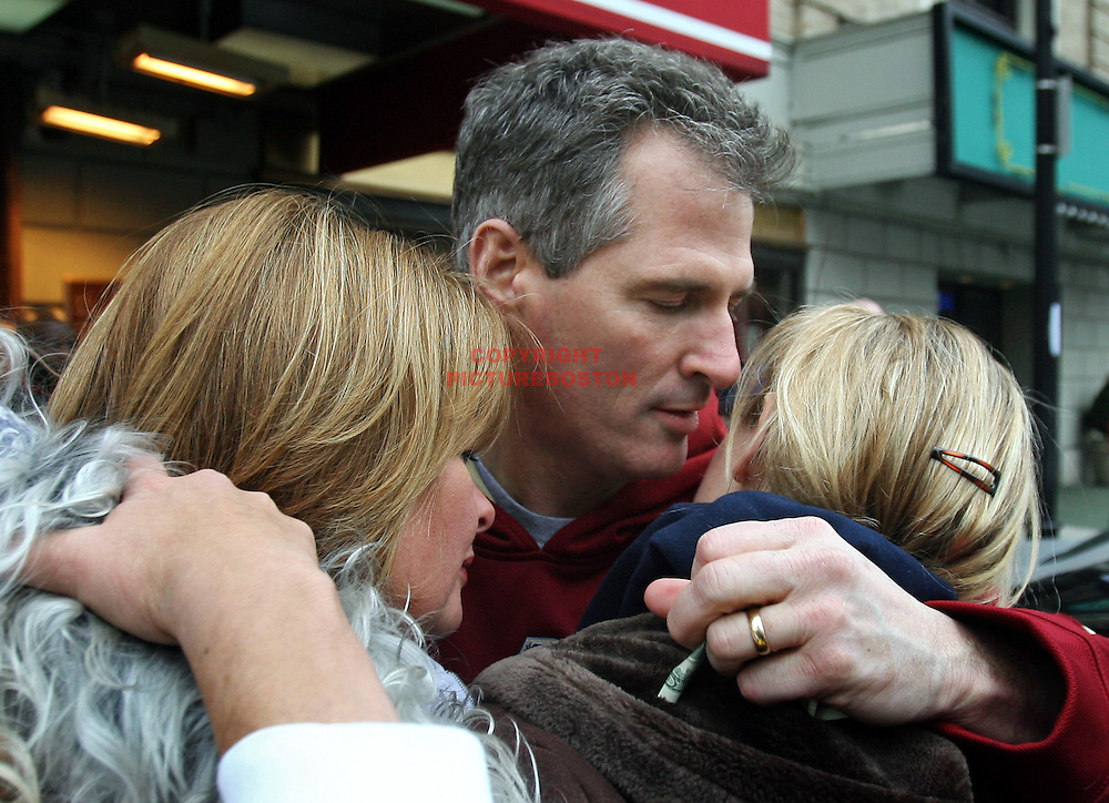 (01/20/10-Boston,MA) US Senator-elect Scott Brown appears outside the Park Plaza Hotel early this morning where he prepared to say goodbye to his daughter Arianna, who was returning to college, as his wife Gail Huff stood by, at left. Staff photo by Mark Garfinkel