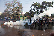 Bangladeshi police fired tear gas to disperse activists during a strike to protest the construction of a coal-fired power plant in Dhaka on January 26, 2016. Clashes erupted in Bangladesh's capital January 26 as police fired tear gas at hundreds of campaigners protesting against a massive coal-fired power plant they say will destroy the world's largest mangrove forest. Witnesses said Shahbagh Square, Dhaka's main protest venue, turned into a battleground as police used water cannon and fired tear gas and rubber bullets at hundreds of left-wing and environmental protesters. © Monirul Alam