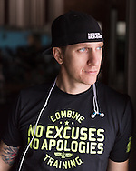Environmental portrait of a personal trainer using available light.