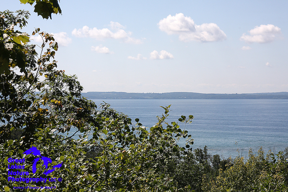 Fluffy white clouds drift over the waters of Little Traverse Bay, just north of Harbor Springs, Michigan.