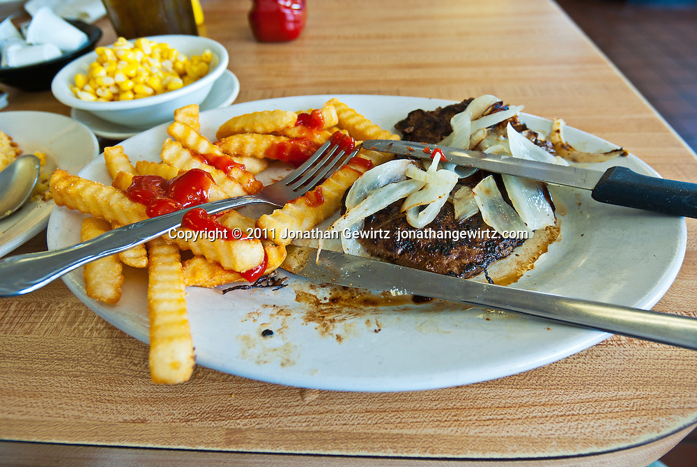 A lunch of liver and onions on a restaurant table. WATERMARKS WILL NOT APPEAR ON PRINTS OR LICENSED IMAGES.
