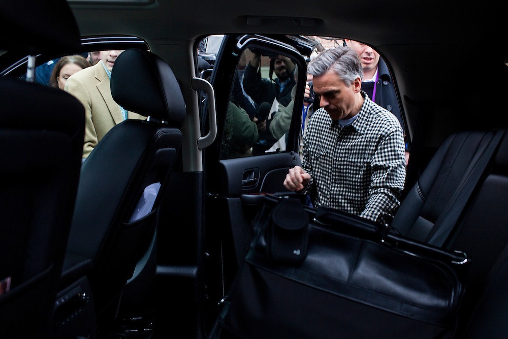 Republican presidential candidate Jon Huntsman gets in his SUV after speaking at the New England College Convention on Friday, January 6, 2012 in Concord, NH.
