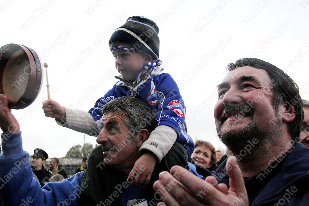 Young Darragh Keane sat proudly on his grandad's William shoulders and beat his drum for Kilkee as a proud Tom Prenderville looked on after his side beat Kilmurry Ibrickane in the county football final in Cusack Park on Sunday.<br />