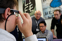 In the back 'subject matter' Howerd Bilofsky, PHD and David Hindin, Temple Physician, Resident Surgeon see how Cole Gleason works on the adaptation of Google Glass in their project.