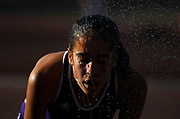 Oct 20, 2006; Walnut, CA, USA; Runners cool off in a water sprinkler station at the 59th Mt. San Antonio College Cross Country Invitational.