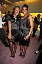 Left to right, ALEXANDRA BURKE winner of X Factor and her sister SHENEICE BURKE at a party to celebrate the opening of the newly refurbished Prada Store 16/18 Old Bond Street, London on 16th February 2009.