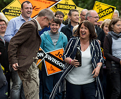 Scottish Lib Dem leader Willie Rennie sees the funny side after being soaked with champagne by new MP Christine Jardine at a victory rally in Milngavie, Glasgow.<br /> <br /> © Dave Johnston/ EEm