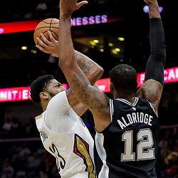 Nov 19, 2018; New Orleans, LA, USA; New Orleans Pelicans forward Anthony Davis (23) shoots over San Antonio Spurs forward LaMarcus Aldridge (12) during the first quarter at the Smoothie King Center. Mandatory Credit: Derick E. Hingle-USA TODAY Sports