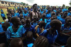July 13, 2017 - Juba, Jubek, South Sudan - Supermodel Ajah Kiir, the South Sudanese 2016 Miss World representative, addresses a group of girls, teaching them how to use hygienepads in the Gumbo Basic Primary School on the outskirts of the South Sudanese capital of Juba.Common practices are as exotic as digging a hole and sitting there for four days to using dung of cows, often with severe health consequences. as fistula and severe infections.Kiir aims to reach girls in all the public schools in Juba, many of which have not been funded in several years in a country where civil war and deep corruption continues, draining budgets, displacing millions and leaving millions more on the edge of starvation. (Credit Image: © Miguel Juarez Lugo via ZUMA Wire)