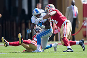 September 16, 2018; Santa Clara, CA, USA; Detroit Lions running back Kerryon Johnson (33) is tackled by San Francisco 49ers defensive end Solomon Thomas (94) in front of 49ers safety Jaquiski Tartt (29) during the second quarter at Levi's Stadium.