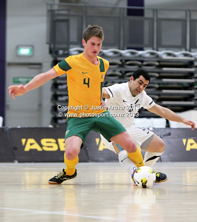 New Zealand's Ouadhah Ragued and Australia's Greg Giovenali compete for the ball during the 2013 ASB Trans Tasman Cup. Futsal Whites v Futsal Roos. ASB Sports Centre, Wellington.  Saturday 20 July 2013. Photo: Justin Arthur / photosport.co.nz