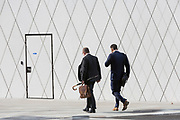 Businessmen with geometric angles and diagonal lines on new architecture at Southwark SE1, on 7th September 2018, in London, England