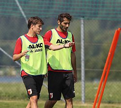 15.07.2013, Walchsee, AUT, FC Augsburg, Trainingslager, im Bild Paul VERHAEGH (FC Augsburg #2) im Gespraech mit Halil ALTINTOP (FC Augsburg #7, re.), // during a trainings session of German 1st Bundesliga club FC Augsburg at their training camp in Walchsee, Austria on 2013/07/15. EXPA Pictures &copy; 2013, PhotoCredit: EXPA/ Eibner/ Klaus Rainer Krieger<br /> <br /> ***** ATTENTION - OUT OF GER *****