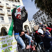 Syrian refugees rally then march to the Russian consulate in Thessaloniki after reports say that Aleppo has been wrested from rebels by the Syrian government after heavy fighting.