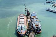 Nederland, Zuid-Holland, Rotterdam, 10-06-2015; Elbehaven, Beneluxhaven. ADM Europoort B.V. (Archer Daniels Midland Company). Bulk carriers voor de zeekade worden gelost door grijperkraan. Op de kade ook graanelevatoren die vroeger gebruikt werden voor lossen van de schepen.<br /> Europoort with bulk carriers at the terminals for dry bulk handling.<br /> luchtfoto (toeslag op standard tarieven);<br /> aerial photo (additional fee required);<br /> copyright foto/photo Siebe Swart
