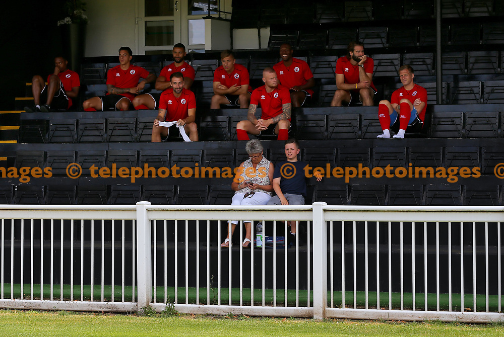 Crawley players sit in the shade during the pre season friendly between Fulham and Crawley Town at Motspur Park Training Ground, London, UK. 07 July 2018.