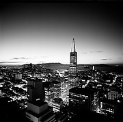Black and white photo of Transamerica pyramid at dusk facing west, including the Golden Gate, San Francisco