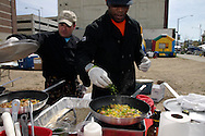 John McInerney (left) and Lawrence Beard cook up some chicken goodness during Taste of Miami Valley and Home Show in downtown Dayton, Saturday, September 18, 2010.