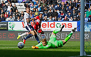 A shot from Britt Assombalonga of Middlesbrough tipped wide by Ben Alnwick of Bolton Wanderers during the EFL Sky Bet Championship match between Bolton Wanderers and Middlesbrough at the Macron Stadium, Bolton, England on 9 September 2017. Photo by Paul Thompson.