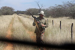 NAMIBIA GROOTFONTEIN 2MAY14 - Farmer Martinus van Blerk sports his rifle on the Omega farm near Grootfontein, Namibia.<br /> <br /> The farm holds about 700 hear of cattle, mostly Brahman-Charolais cross breeds. <br /> <br /> <br /> <br /> jre/Photo by Jiri Rezac<br /> <br /> <br /> <br /> © Jiri Rezac 2014