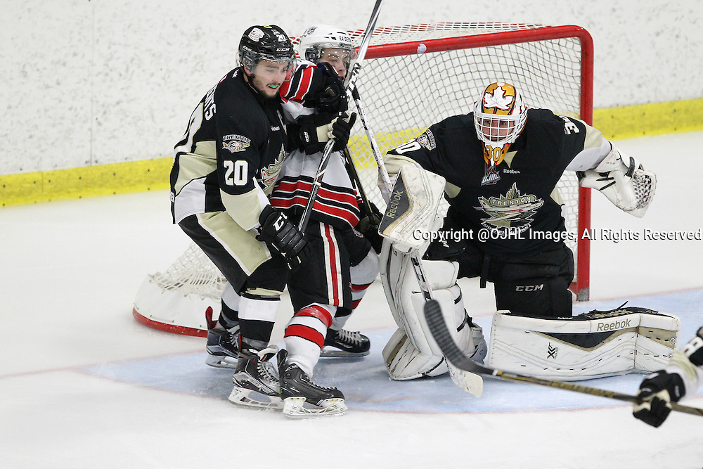 GEORGETOWN, ON - Apr 16, 2016 -  Ontario Junior Hockey League game action between Trenton Golden Hawks and the Georgetown Raiders. Game 2 of the Buckland Cup Championship Series. at the Gordon Alcott Memorial Arena in Georgetwon, Ontario. Adam Clements #20 of the Trenton Golden Hawks protects the crease during the overtime period.<br /> (Photo by Tim Bates / OJHL Images)