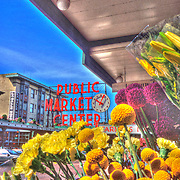 Pike Place Market, Seattle, Washington, view of historic trademark market clock sign from corner flower stand at First and Pike