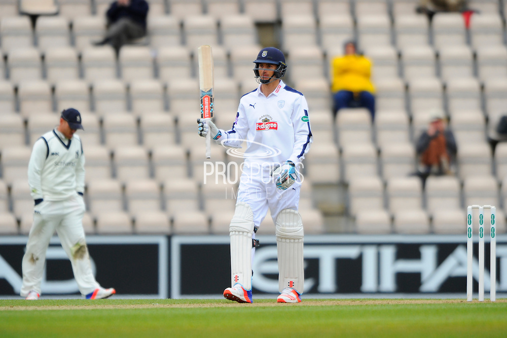 50 runs for McLaren - Hampshire batsman Ryan McLaren  raises his bat to the crowd after scoring a vital 50 for Hampshire during the Specsavers County Champ Div 1 match between Hampshire County Cricket Club and Warwickshire County Cricket Club at the Ageas Bowl, Southampton, United Kingdom on 10 April 2016. Photo by Graham Hunt.